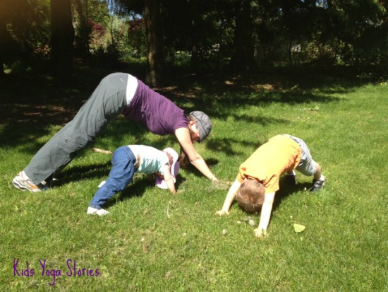 Downward-Facing Dog Pose with family in park on Kids Yoga Stories