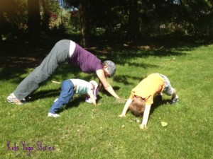 Downward Facing Dog Poses with family in park by Kids Yoga Stories