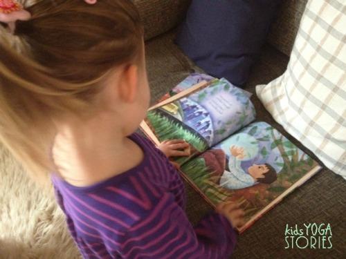 Girl reading Visiting Feelings Book on Kids Yoga Stories