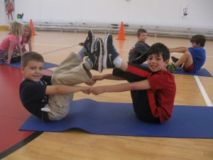 Partner Boat Pose at school by Jodi B.