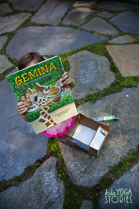 My daughter holding up the book, Gemina, as part of our summer book exchange