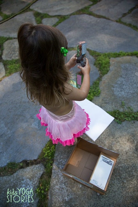 My daughter opening up the Safari Ltd Zoo Babies Toob as part of our summer book exchange