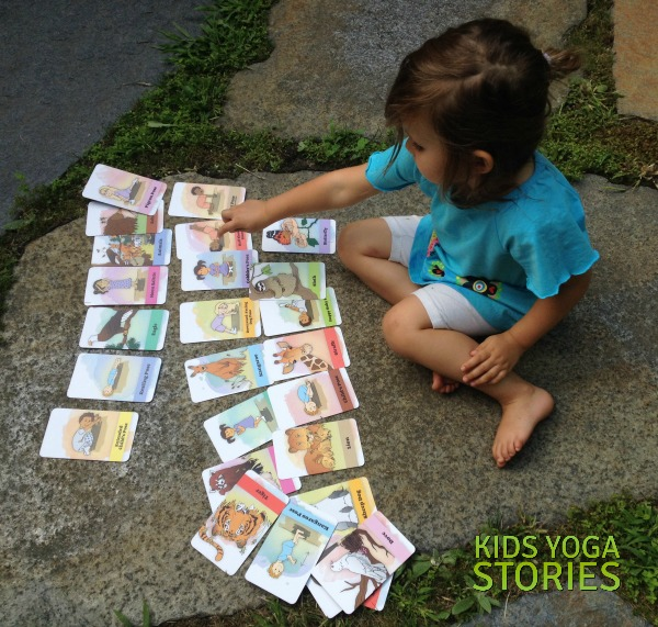 My daughter playing with our new Bedtime Yoga Cards -- Kids Yoga Stories