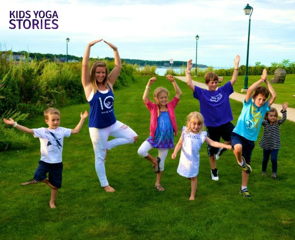 Yogis on the beach: family yoga practicing Tree Pose on Kids Yoga Stories