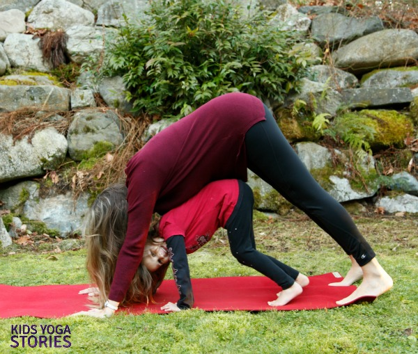 Double Downward-Facing Dog Pose: easy partner yoga poses for kids   Kids Yoga Stories