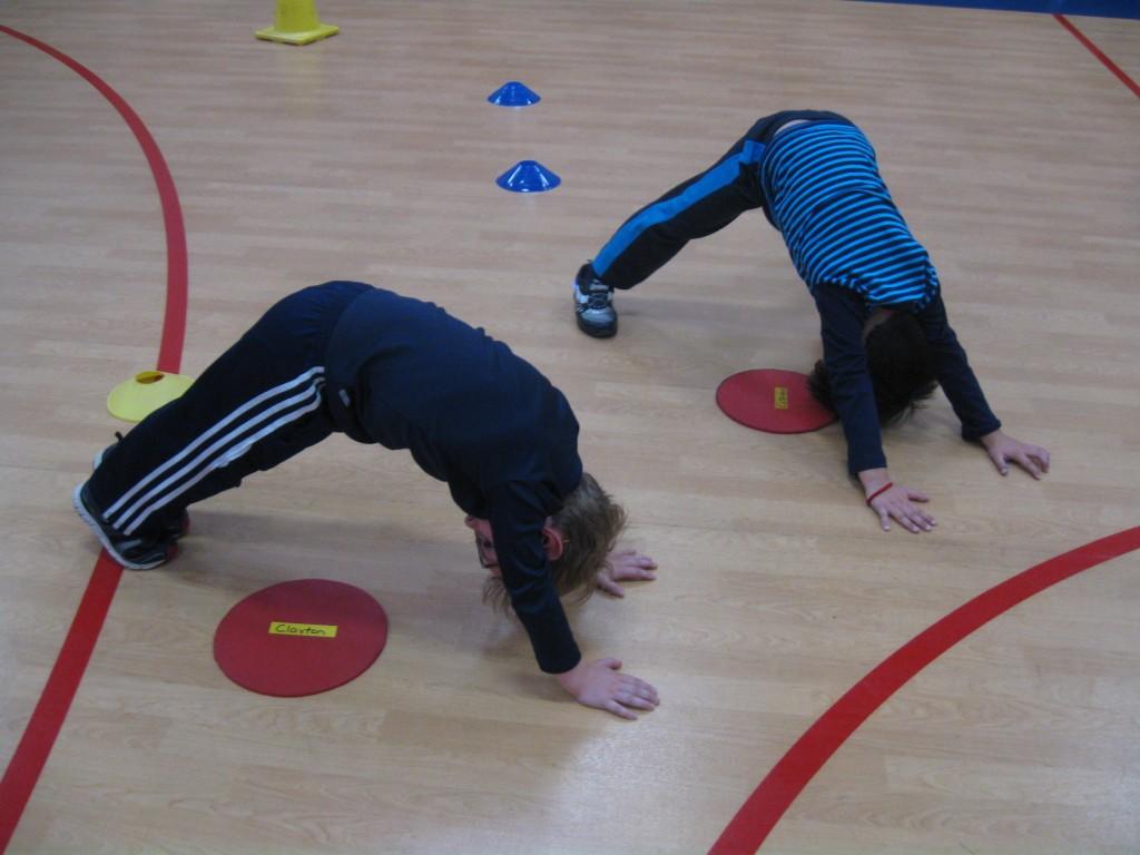 Yoga games playing with large groups: practicing Downward-Facing Dog Pose   Kids Yoga Stories