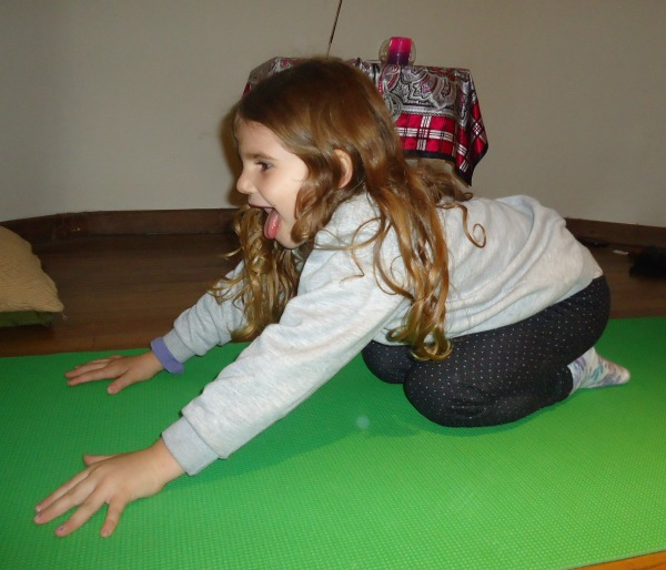 Kindergarten yoga student practicing Lion Pose | Kids Yoga Stories