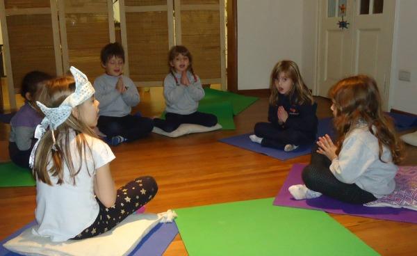 Kindergarten yoga students saying Namaste | Kids Yoga Stories
