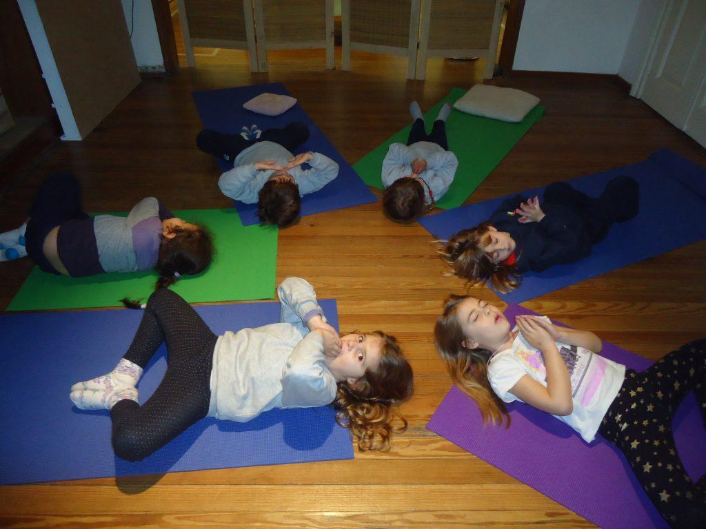 Kindergarten yoga students practicng the Bubble Meditation
