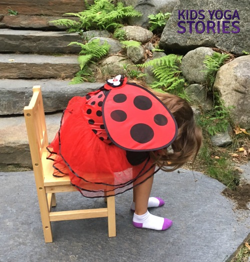 Child's Pose in a chair pretending to be a ladybug for Halloween | Kids Yoga Stories
