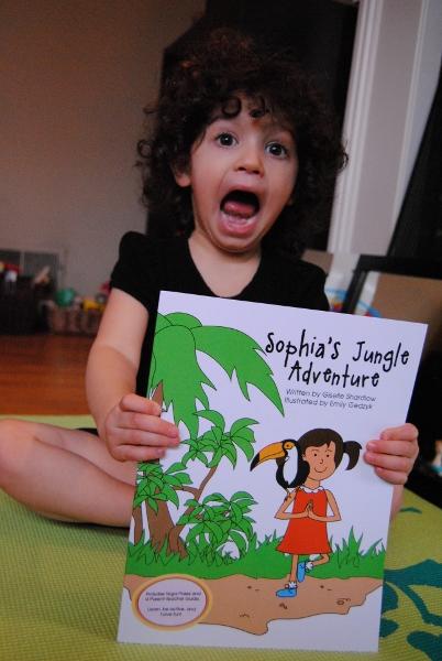 Litlte girl reading Sophia's Jungle Adventure by Kids Yoga Stories