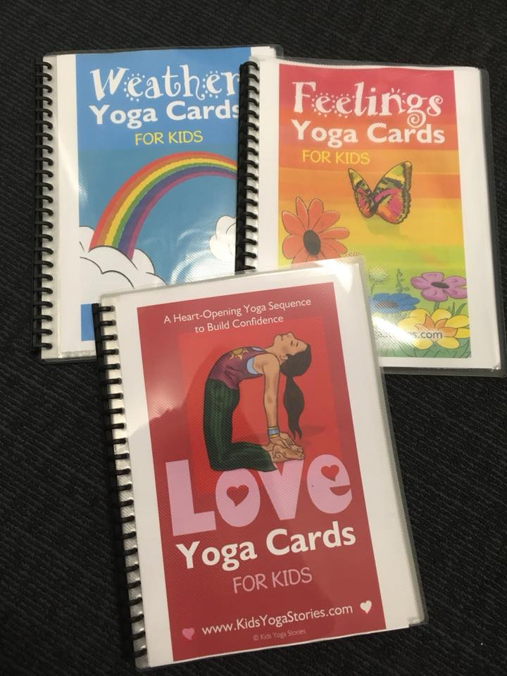Digital yoga cards printed out and put into plastic pocket display books for easy reference | Kids Yoga Stories